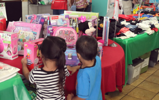 Children Looking at Christmas Store
